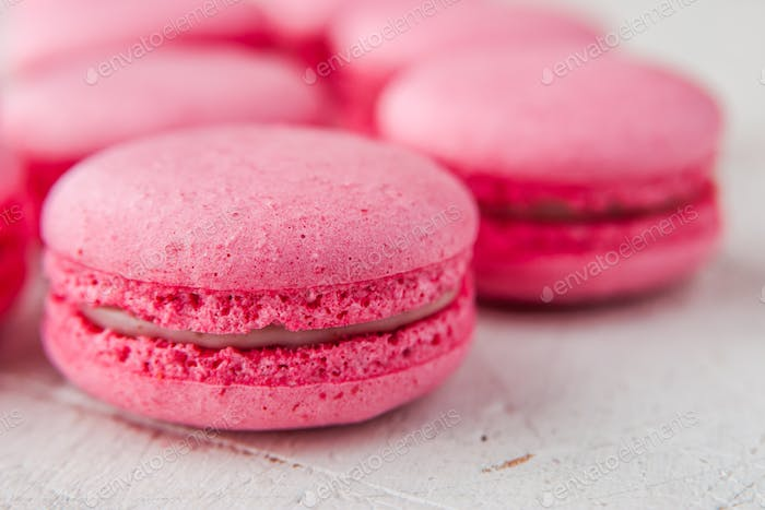 Pink macaroon on a white table