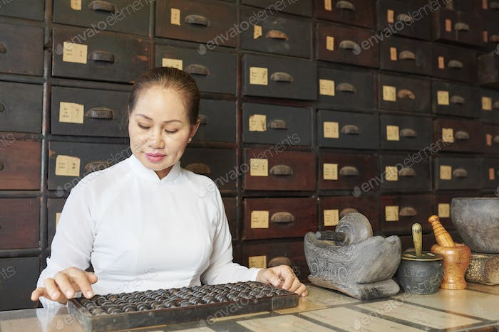 Woman working at old apothecary