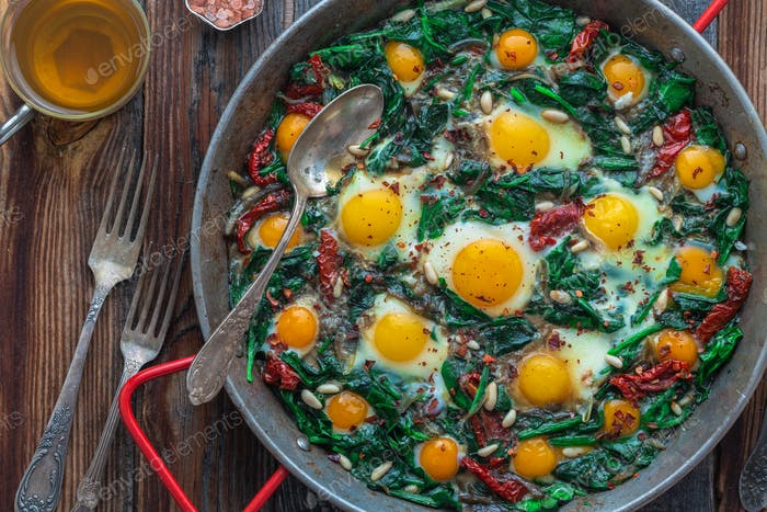 Close view of spinach and fried eggs