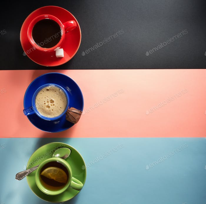 cup of coffee and tea at colorful background