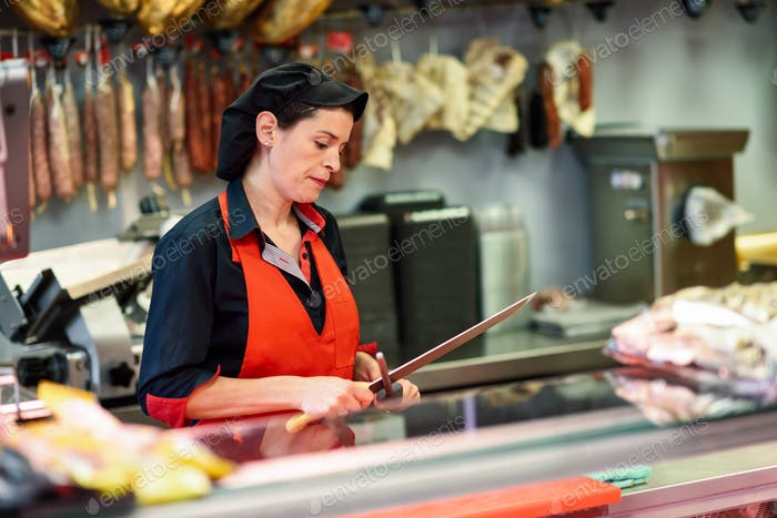 Butcher sharpening a knife in a butcher shop