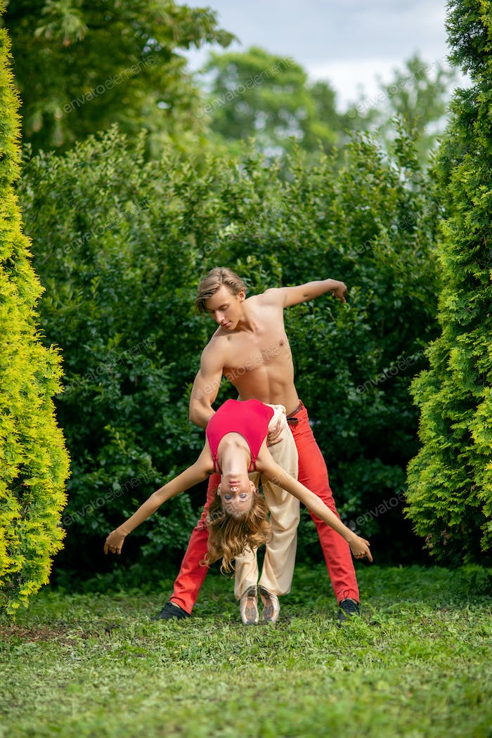 beautiful modern ballet couple dancing in summer outdoors