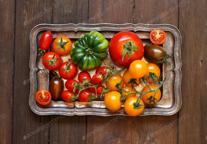 Colorful tomatoes on a metal tray
