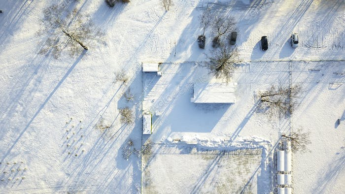 Aerial view of snow covered park.