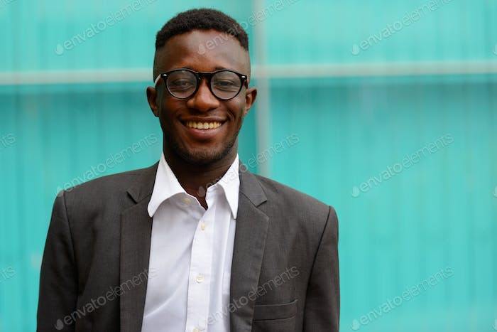 Young African businessman in the city outdoors