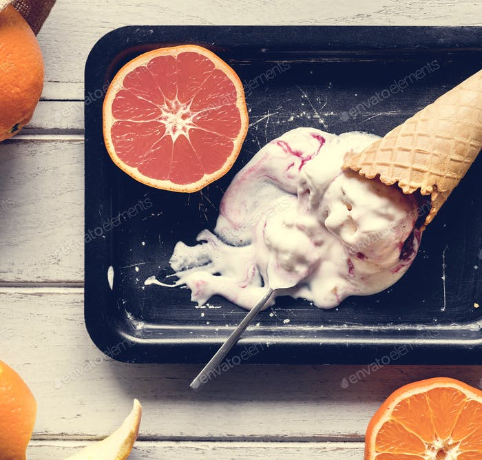 Delicious ice cream and oranges