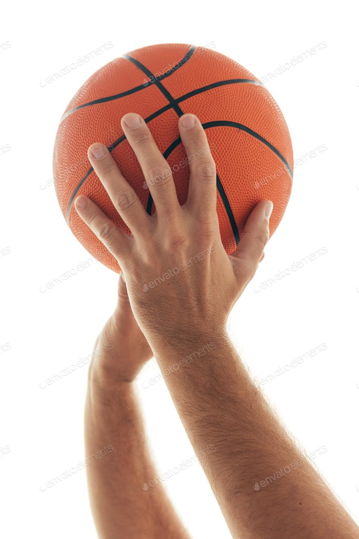 Male hand with basketball ball isolated on white background