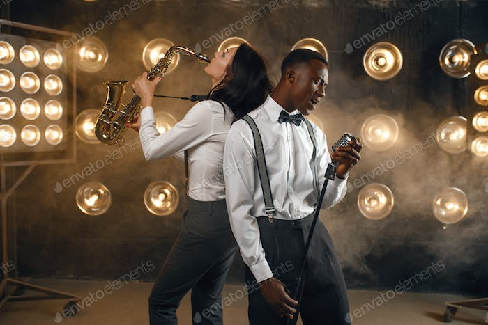 Male jazz performer and female saxophonist