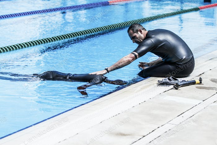 Coach Holding a Performer during Static Apnea Competition