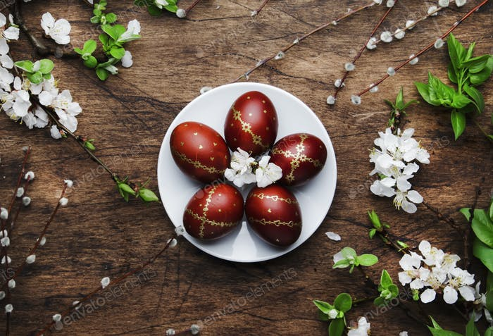 Easter eggs and spring flowers and willow branches