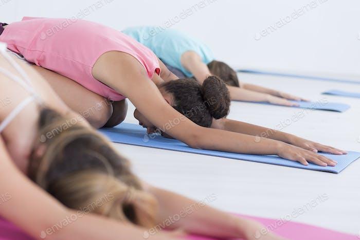 Stretching class on foam pads