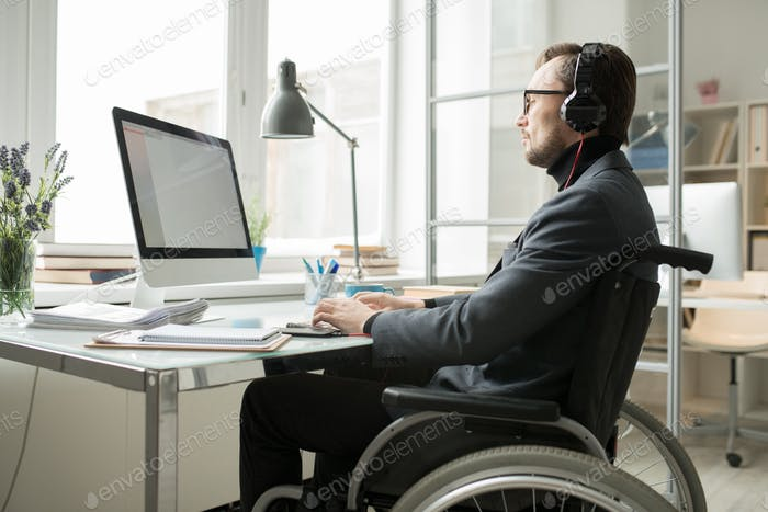 Busy businessman in wheelchair