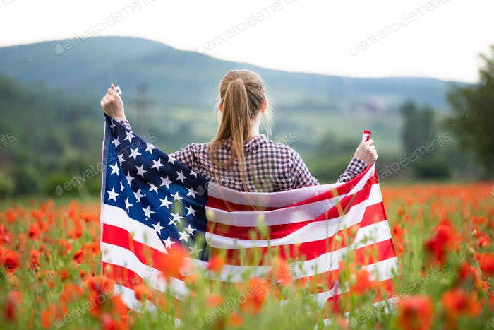 Patriot woman holding the american flag on the 4th of July