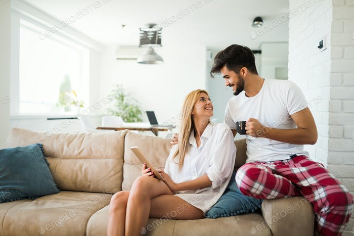 Couple shopping online using tablet at home