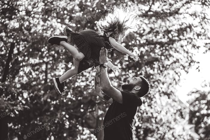 Dad and little daughter have fun and playing