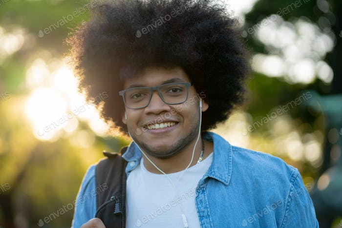Portrait of young latin man outdoors.