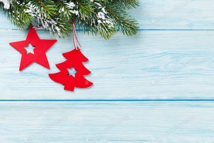 Christmas fir tree and decor over blue wood