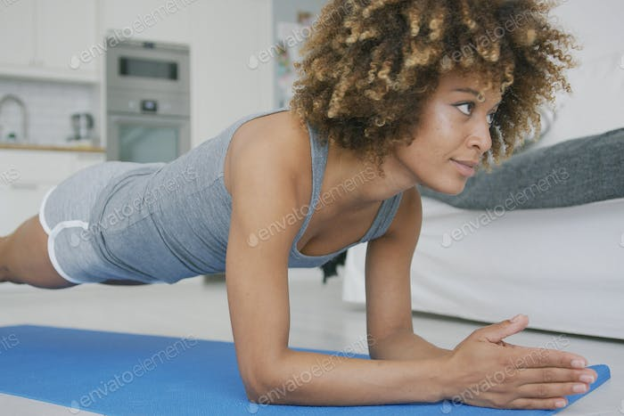 Beautiful woman training abs at home