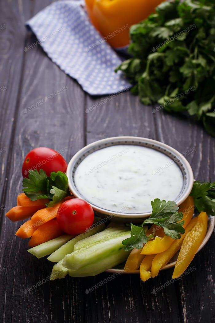 Fresh vegetables stick and yogurt dip