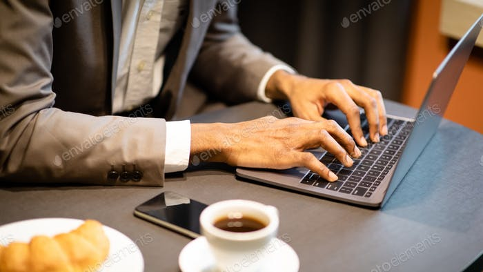 Cropped image of busy guy using computer