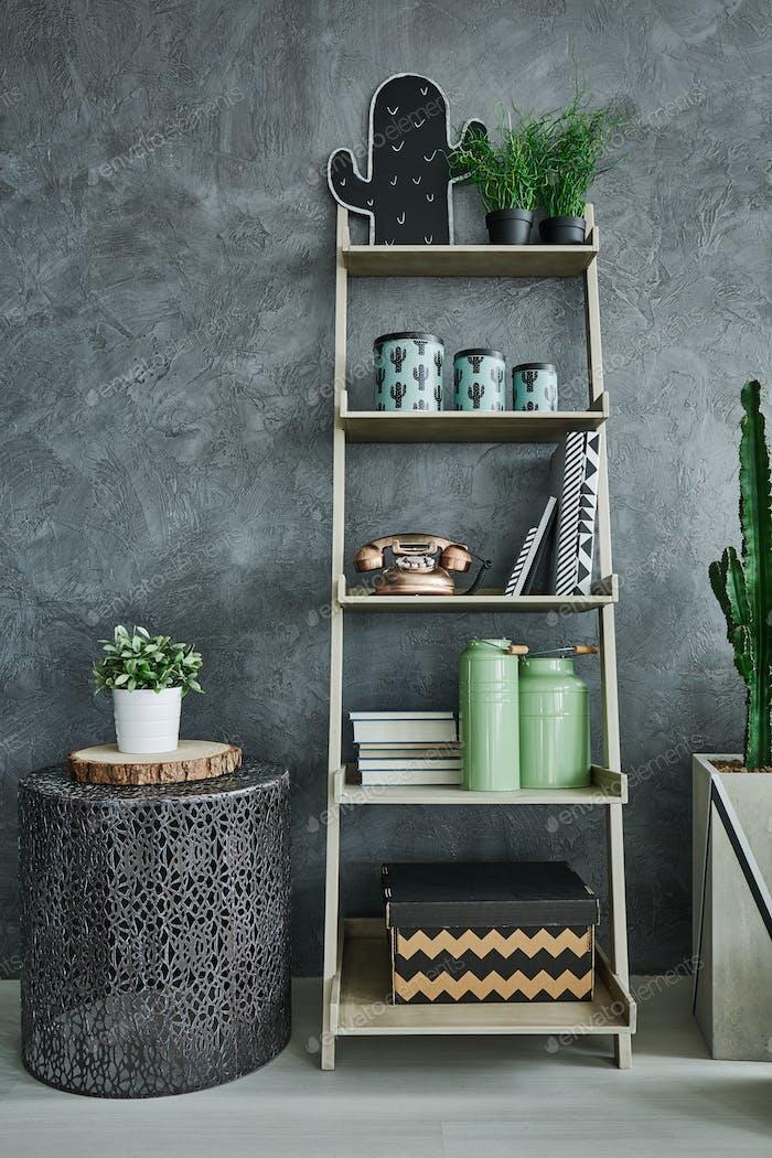 Grey wall stucco and bookshelf