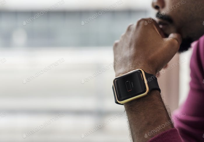 African man wearing a smartwatch