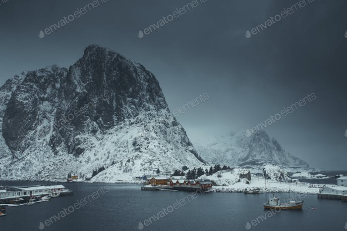 Snowy fishing village at Moskenesøya island, Norway
