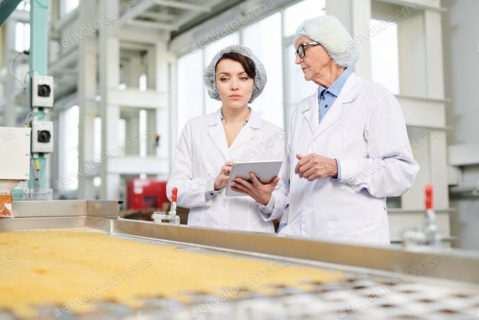 Female Workers Overseeing Food Production