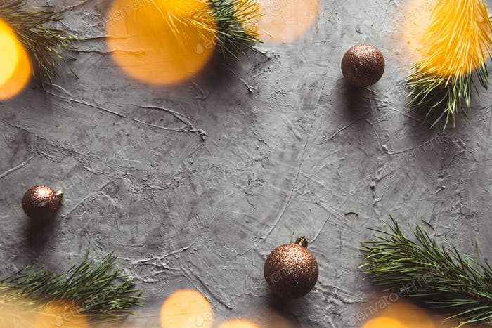 Christmas and New year decorative background border with golden toys on Christmas tree. Flat lay