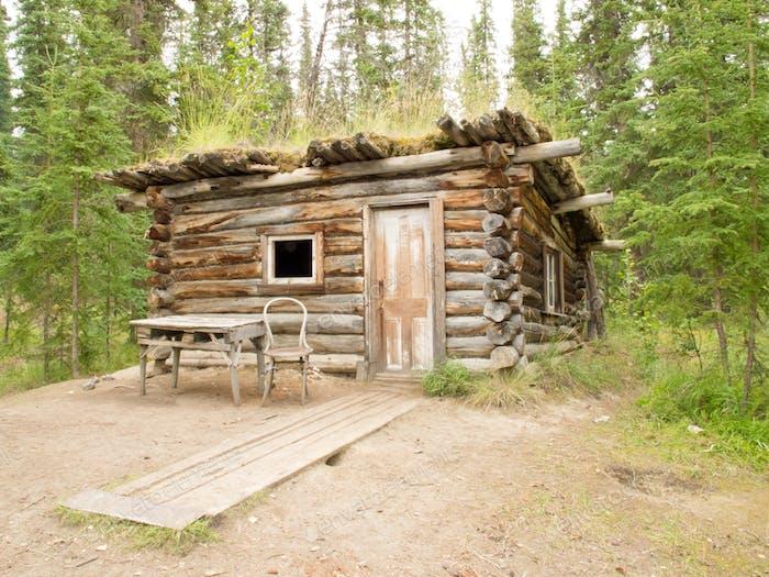 Old traditional Yukon log cabin Canada