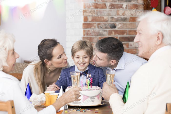 Boy celebrating birthday with family