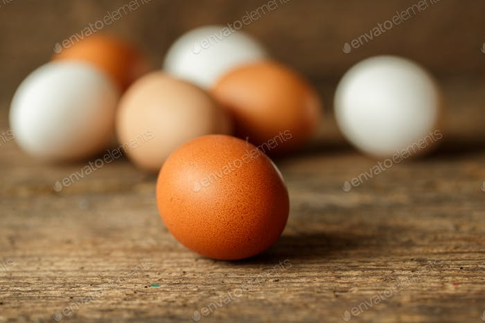 Fresh chicken eggs on a wooden  background