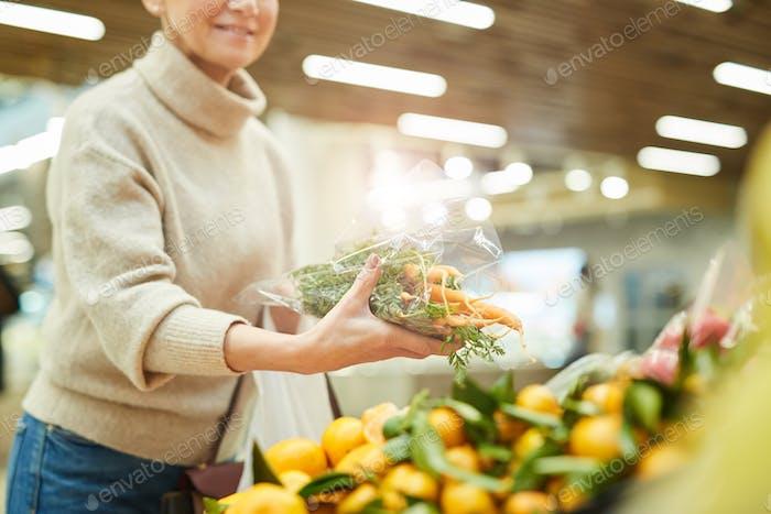 Woman Buying Fresh Vegetables at Market