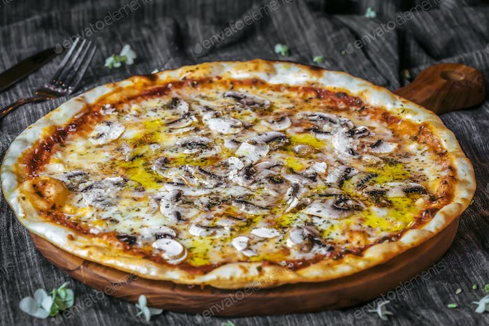 Closeup of Vegetariana Pizza on wooden table, mushrooms