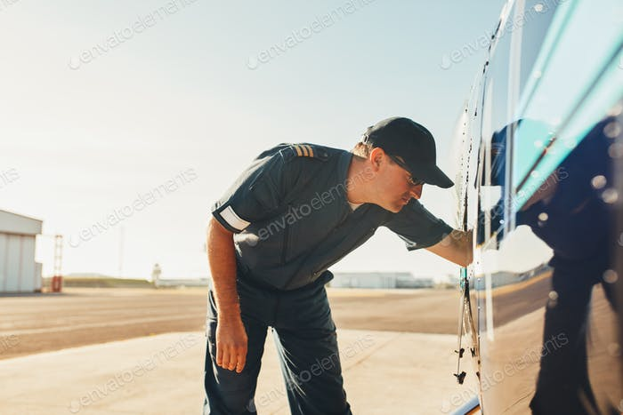 Pilot checking the engine condition of helicopter