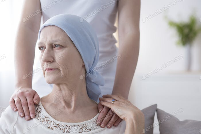 Worried elderly woman with cancer