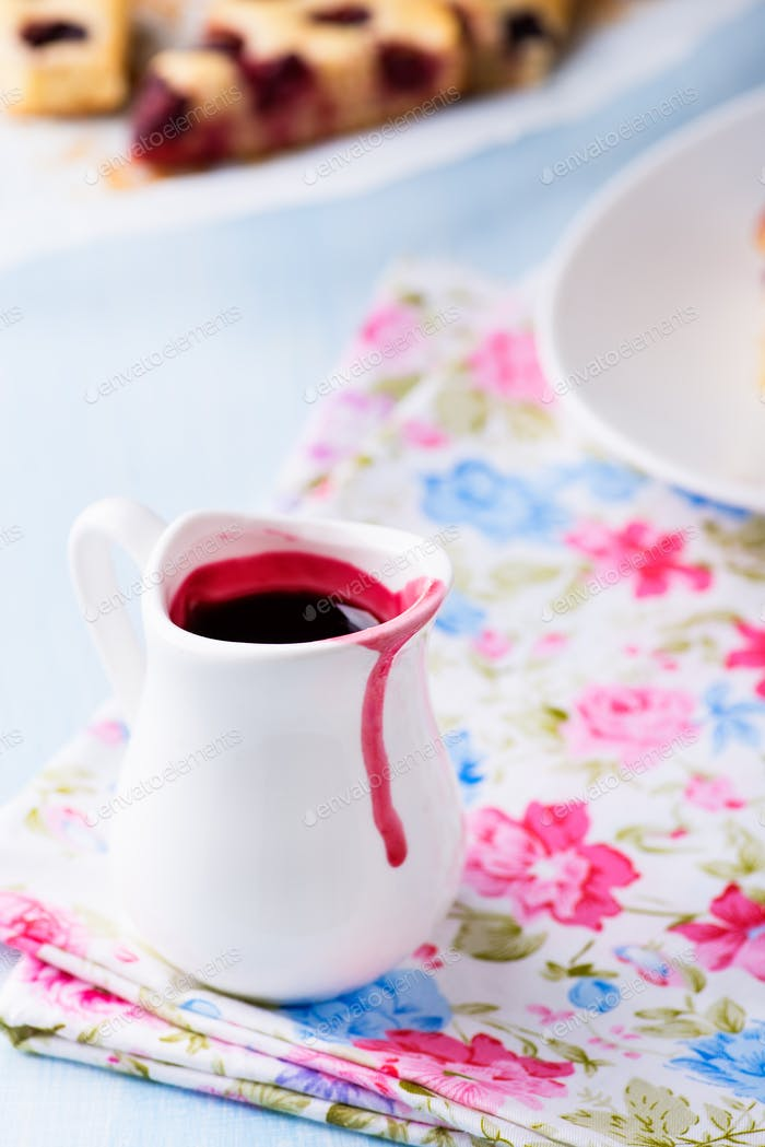 Berry sauce in white milk jug