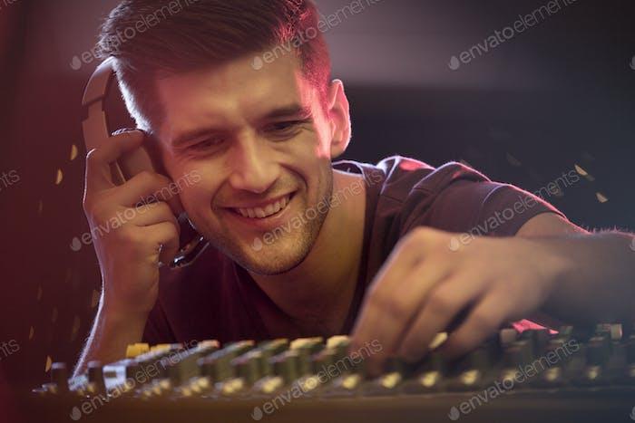 Happy dj mixing music
