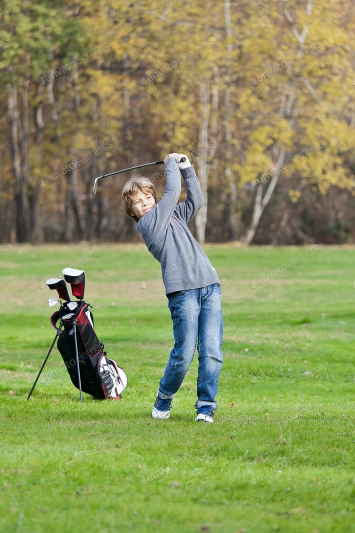 Young golfer swing