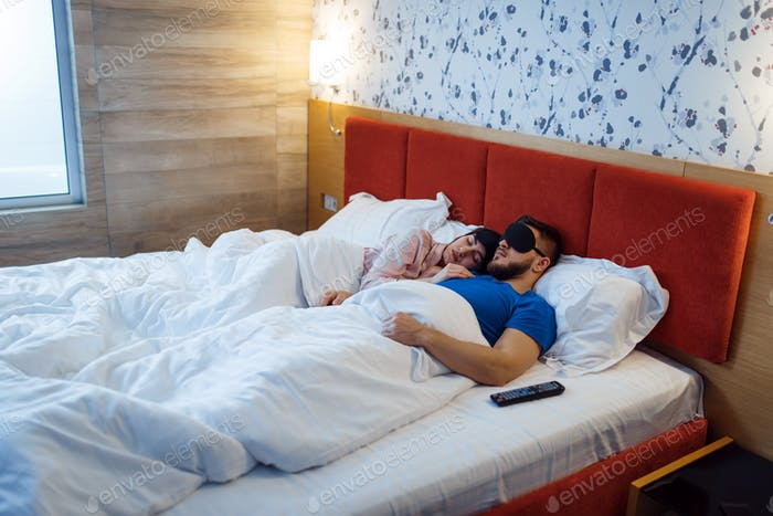 Love couple sleeping in eye covers, healthy sleep