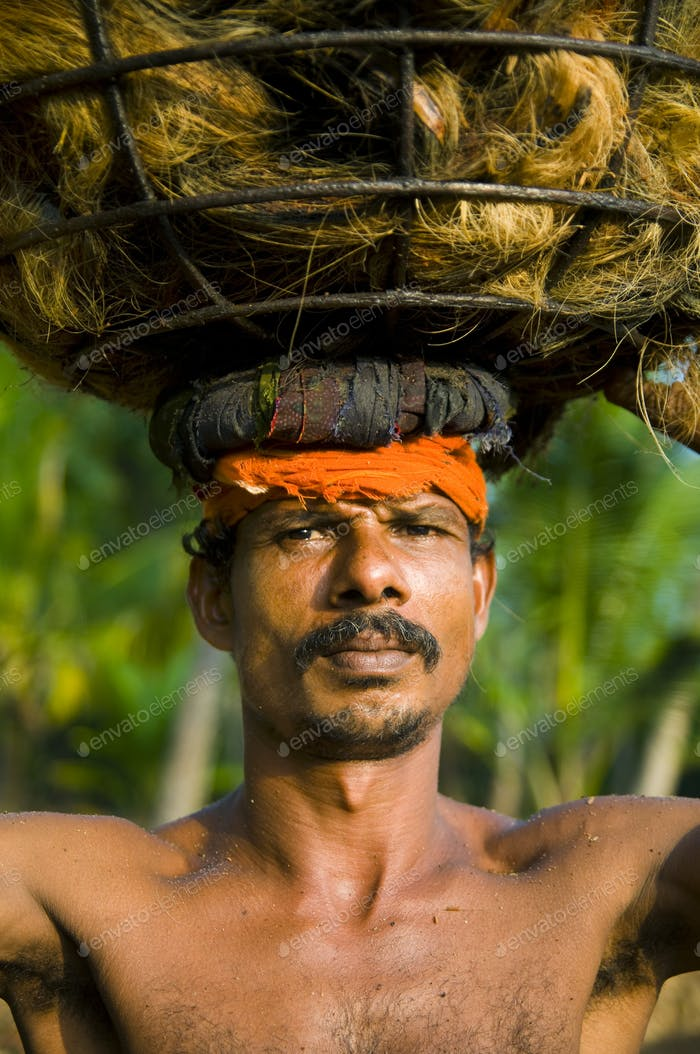 Indigenous Manual Labor Worker Carrying On The Head