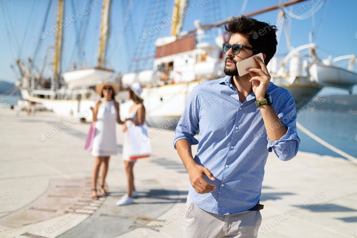 Happy young friends on luxury vacation. Travel, shopping, fun, friends concept