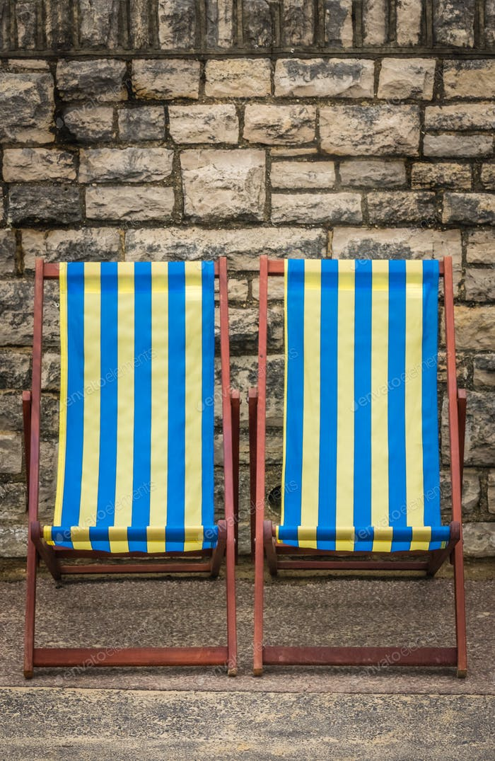 Empty colorful striped  deckchairs