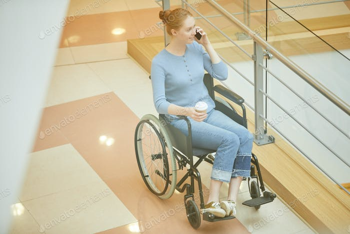 Disabled woman is in shopping mall