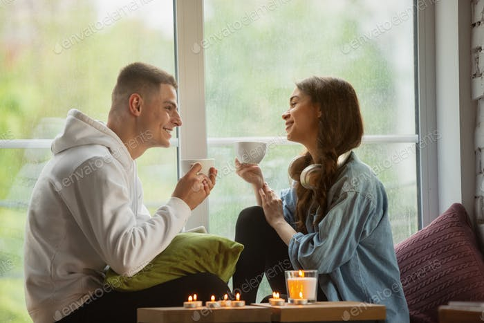Quarantine lockdown, stay home concept - young beautiful caucasian couple enjoying new lifestyle