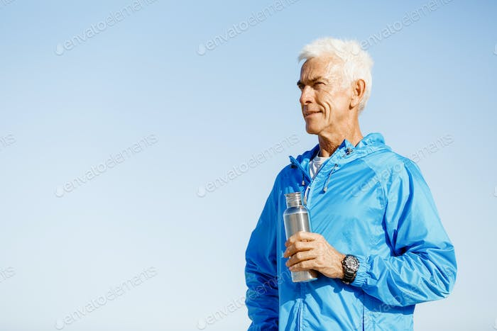 Confident man holding bottle with water