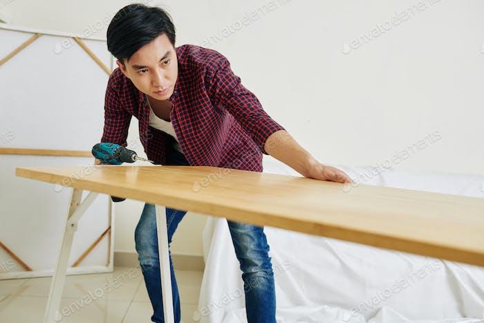 Man assembling table