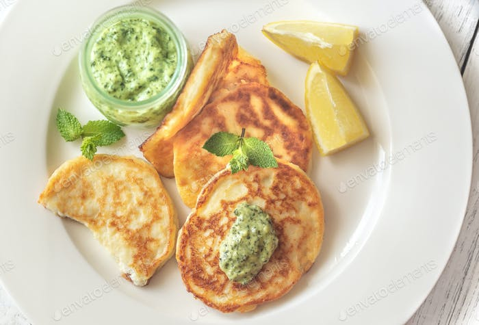 Portion of ricotta fritters with mint sauce