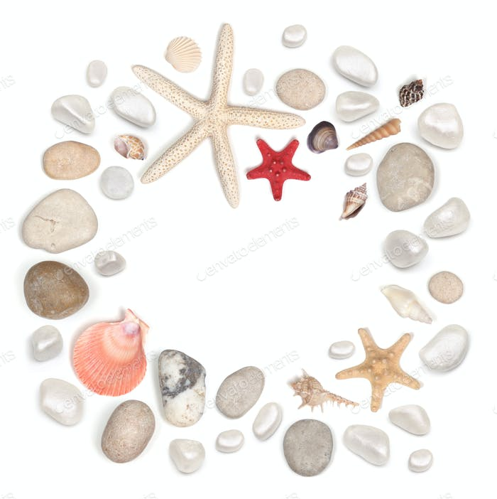 frame of stones and seashell isolated on white