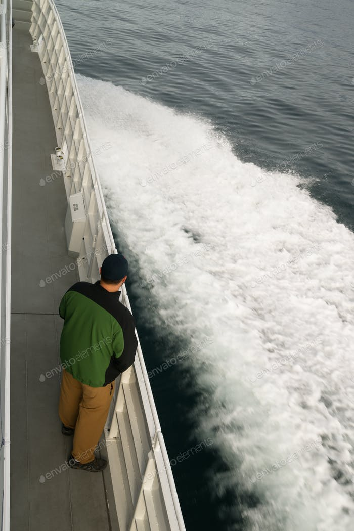 Speeding Ferry Boat Wake of Ocean Spray Man Looking